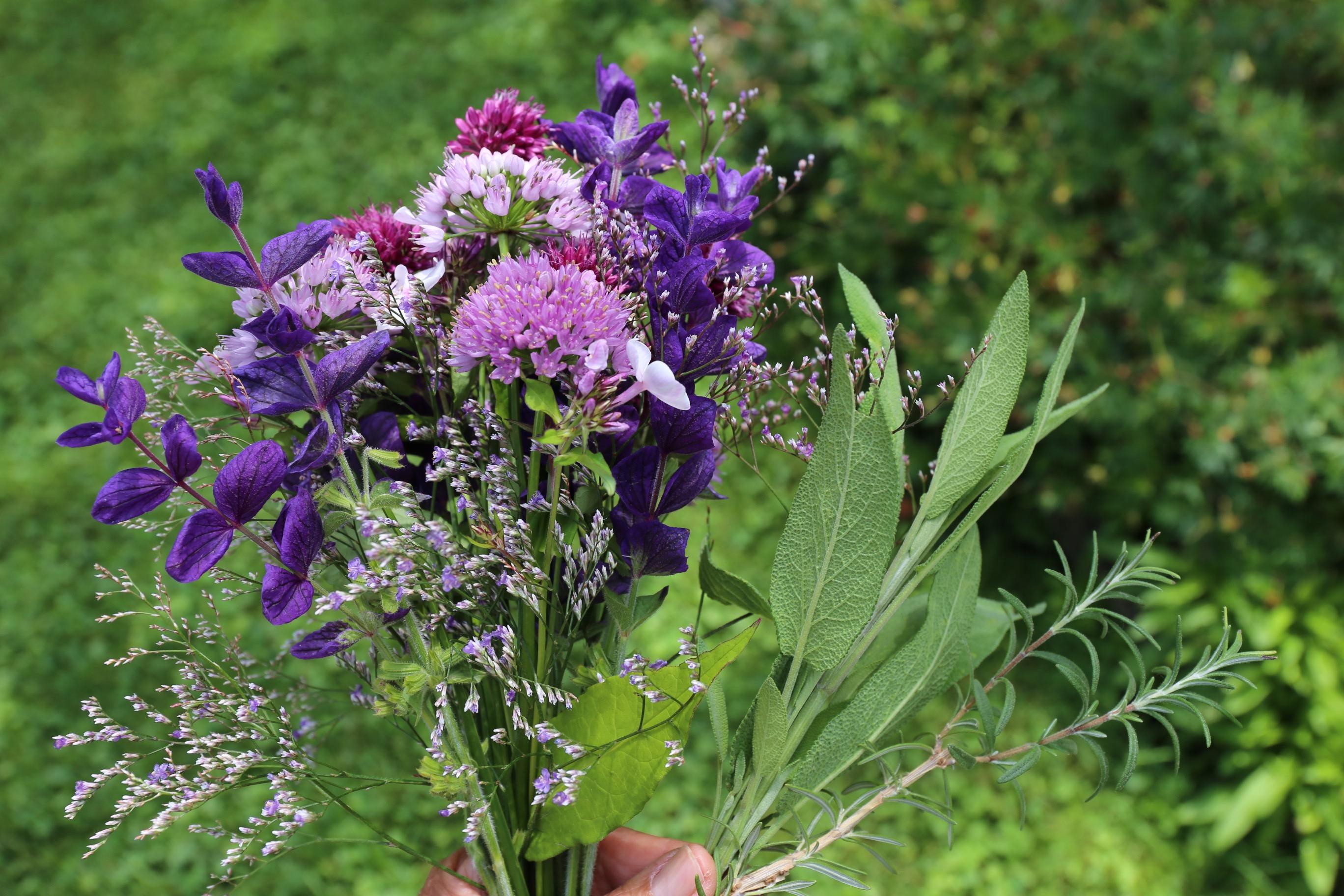 adding foliage to flower arrangement